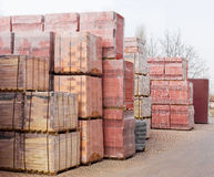 Pallets of yellow and red perforated bricks on a warehouse Royalty Free Stock Photo