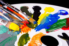 Pallette with brushes and paints Royalty Free Stock Photo