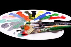 Pallette with brushes and paints Stock Photos