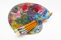 Pallette with brushes Stock Photo