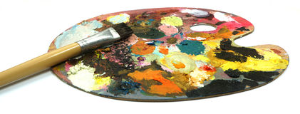 Pallette with brushes on a white background Royalty Free Stock Photo