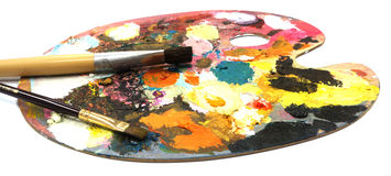 Pallette with brushes on a white background Stock Image