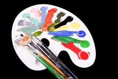 Pallette With Brushes And Paints Royalty Free Stock Photos