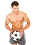 Pallone da calcio bello della tenuta dell'uomo su bianco Fotografia Stock Libera da Diritti