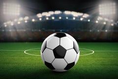 Pallone da calcio con il fondo dello stadio di calcio Fotografia Stock