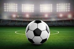 Pallone da calcio con il fondo dello stadio di calcio Fotografie Stock Libere da Diritti