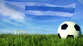 Pallone da calcio con la bandiera dell'Uruguai per il gruppo di avvenimento sportivo Fotografia Stock