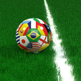 Pallone da calcio con la coppa del Mondo Team Flags Fotografie Stock