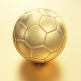 Pallone da calcio dorato Immagini Stock