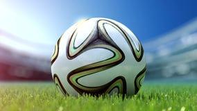 Pallone da calcio moderno in erba rappresentazione 3d Fotografia Stock Libera da Diritti