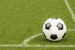 Pallone da calcio nell'angolo del campo di football americano, rappresentazione 3D Immagine Stock