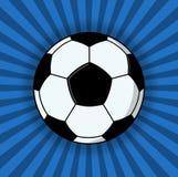 Pallone da calcio su fondo blu Fotografia Stock Libera da Diritti