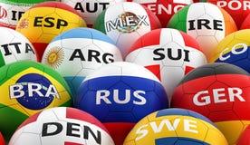 Palloni da calcio colorati nei colori differenti della bandiera nazionale Immagini Stock