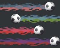 Palloni da calcio su fuoco Fotografia Stock Libera da Diritti