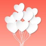 Palloni del cuore di giorno di biglietti di S. Valentino su fondo rosa Immagine Stock
