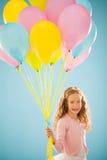 Palloni della tenuta della ragazza Immagine Stock Libera da Diritti