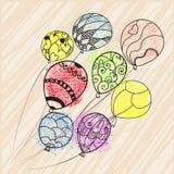 Palloni variopinti che volano nel cielo Fotografie Stock