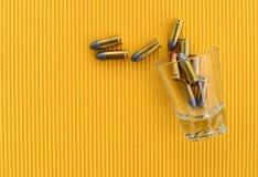 Pallottola in bicchiere Fotografie Stock