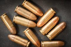 pallottola di 9mm per una pistola Fotografie Stock Libere da Diritti
