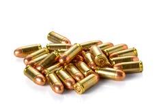 Pallottola disposta su fondo bianco Immagini Stock