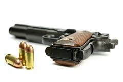 Pallottole con la pistola semiautomatica Fotografie Stock