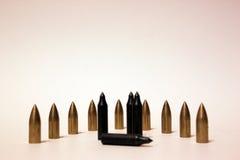 Pallottole della freccia sui precedenti bianchi Immagine Stock