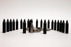 Pallottole sui precedenti bianchi Immagine Stock