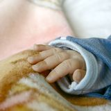 Palm of a baby, close up. Subtle colors royalty free stock photo