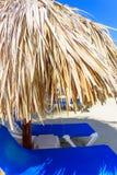 Palm beach chaise longue. Group deck chairs under an umbrella on a sandy beach sea stock photography
