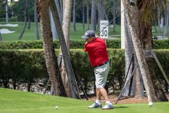 Palm Beach, Florida USA - March 27, 2019: Man playing in a golf in Palm Beach, FL stock photography