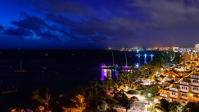 Night time on Palm Beach. Aruba`s West coast tourist destination. Palm beach, the hotel district on the west coast of Aruba. A small Dutch Caribbean Island with stock images