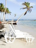Palm Beach Tropical Holiday with Chairs on the white sand with cloudy blue sky Stock Images