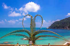 Palm branches in the form of heart on sea Royalty Free Stock Photos
