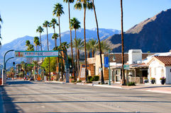 Palm Canyon Dr and palm trees in Palm Springs Royalty Free Stock Photo