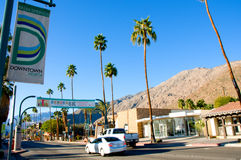 Palm Canyon Dr and palm trees in Palm Springs Stock Photography