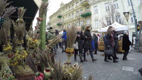 Palm decorations and people in spring event market fair stock video footage