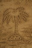 Palm drawing in the sand Stock Image