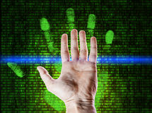 Palm fingerprint is scanned against  numbers matrix Royalty Free Stock Photos
