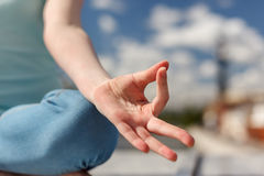 The palm in a gesture of concentration while meditate Stock Photos