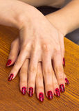 Palm of the girl with red nail Polish, on one another Royalty Free Stock Photos
