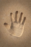 Palm(hand) icon or sign creation in beach sand - concept photo Royalty Free Stock Photography