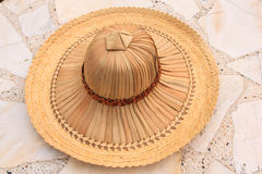 Palm hat for farmers. On marble background Stock Image
