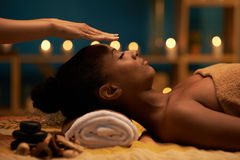 Palm healing. Therapist holding hands above head of the patient to transfer energy stock photo