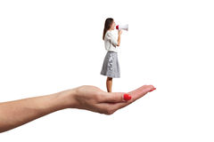 Palm holding small screaming woman royalty free stock photo