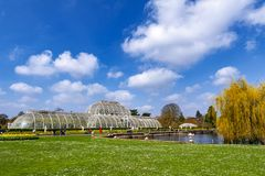 Palm House, an iconic Victorian glasshouse that recreates a rainforest climate located at Kew Garden, England. London, UK - April 2018: Palm House, an iconic Royalty Free Stock Photos