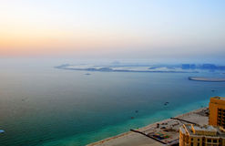 Palm Jumeirah Island. A high level view of the coast of Dubai Marina showing the Palm Jumeirah in the background royalty free stock images