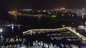 Palm Jumeirah with yahcts in harbor and Atlantis stock video footage