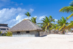 Palm leaf roof bungalow on the tropical beach Stock Photos