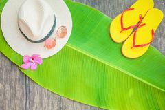 Palm leaf Straw hat Pink sunglasses Beach flip-flops Summer background. Copy space Top view royalty free stock images
