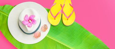 Palm leaf Straw hat Pink sunglasses Beach flip-flops Summer background. Copy space Top view royalty free stock photos
